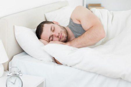 Serene man sleeping in his bedroom